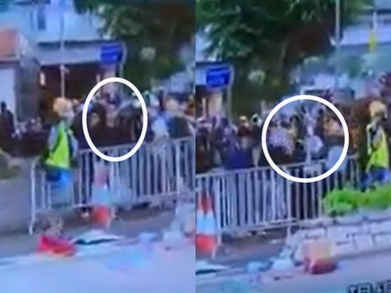 示威者搬鐵馬期間被射中頭部。無綫新聞片段