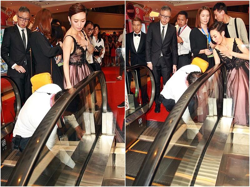周家怡被扶手電梯「食裙」。