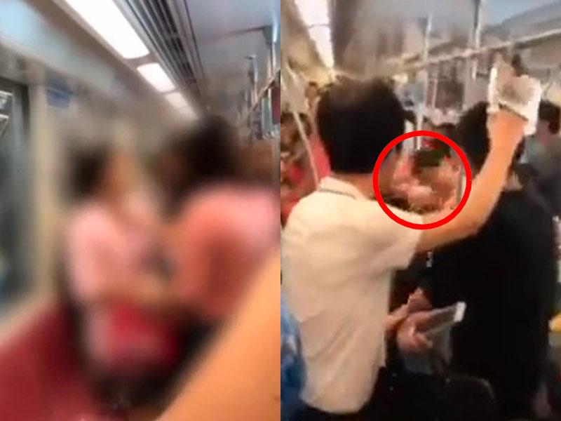 兩年輕媽媽地鐵上因小孩坐得太迫,與鄰座大打出手,穿粉紅衣服的女子,衫都被撕開,場面尷尬。(網圖)