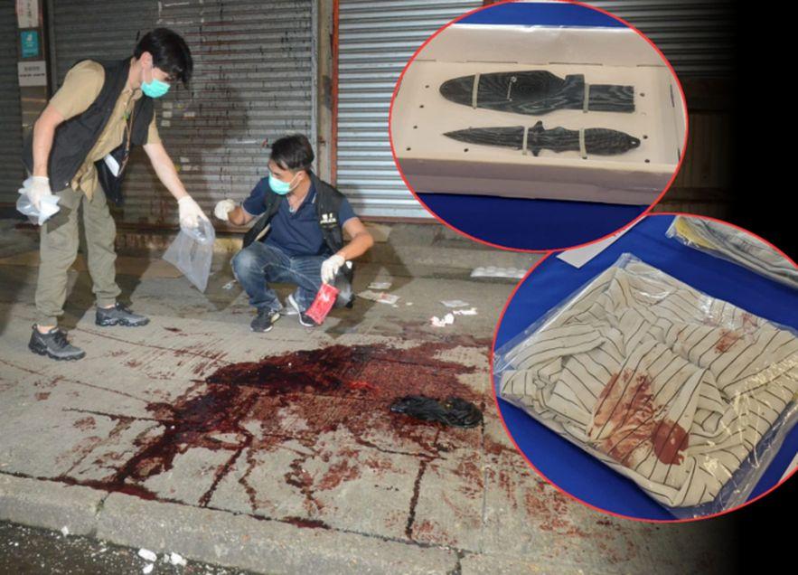 警方展示檢獲的證物,包括血衣。