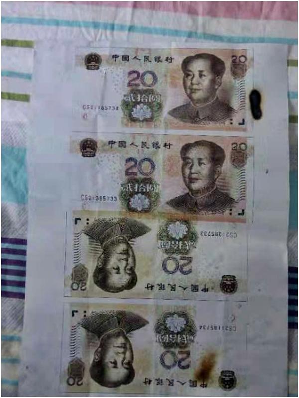 民警搜出少量偽造的一元、五元、十元、二十元面值的假幣。