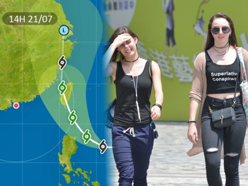 明日天氣酷熱,最高氣溫約34度。部分地區有煙霞。資料圖片