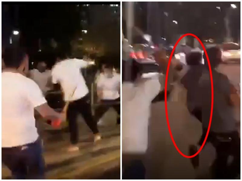 白衣人街頭追打某人。影片截圖