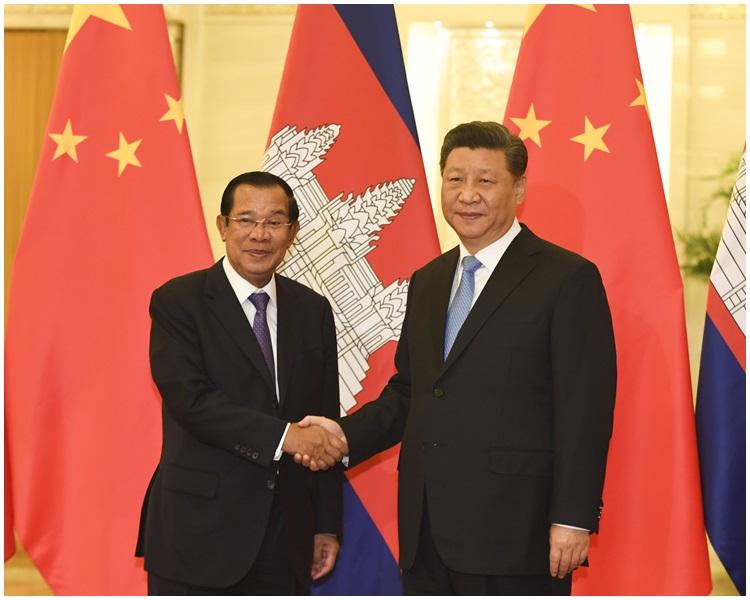 柬埔寨總理洪森與國家主席習近平。AP圖片