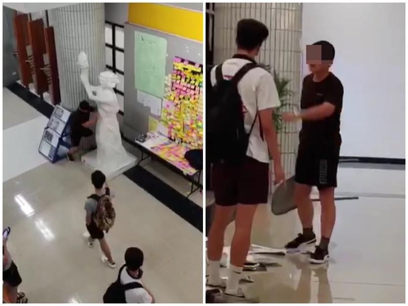 男子推倒女神像後持膠椅與途人對峙。影片截圖