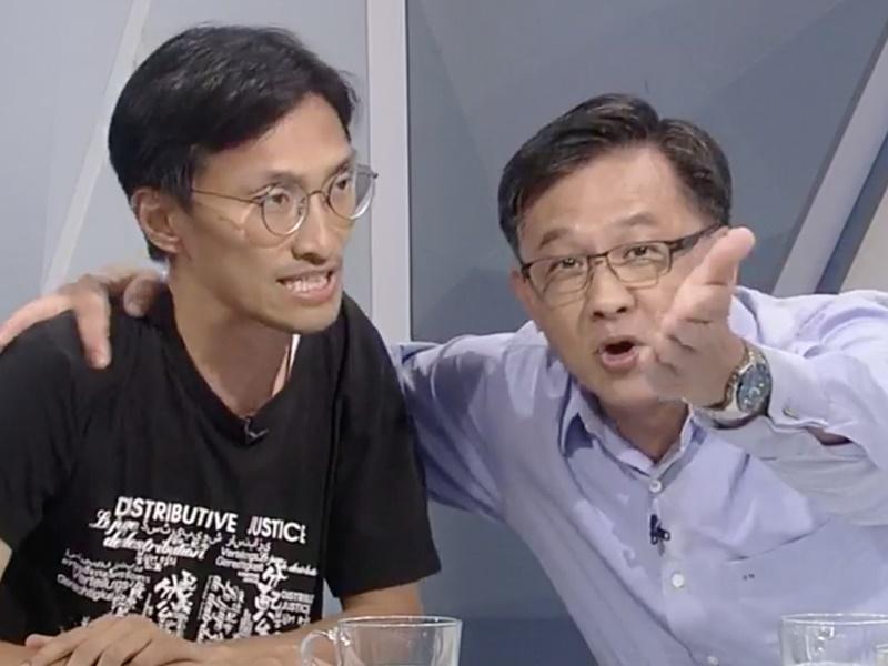 何君堯(右)指朱凱廸支持者破壞家墳。港台圖片