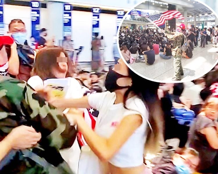 一名女子(左)懷疑不滿有人在場揮動外國旗幟,在場一度與示威者發生口角。