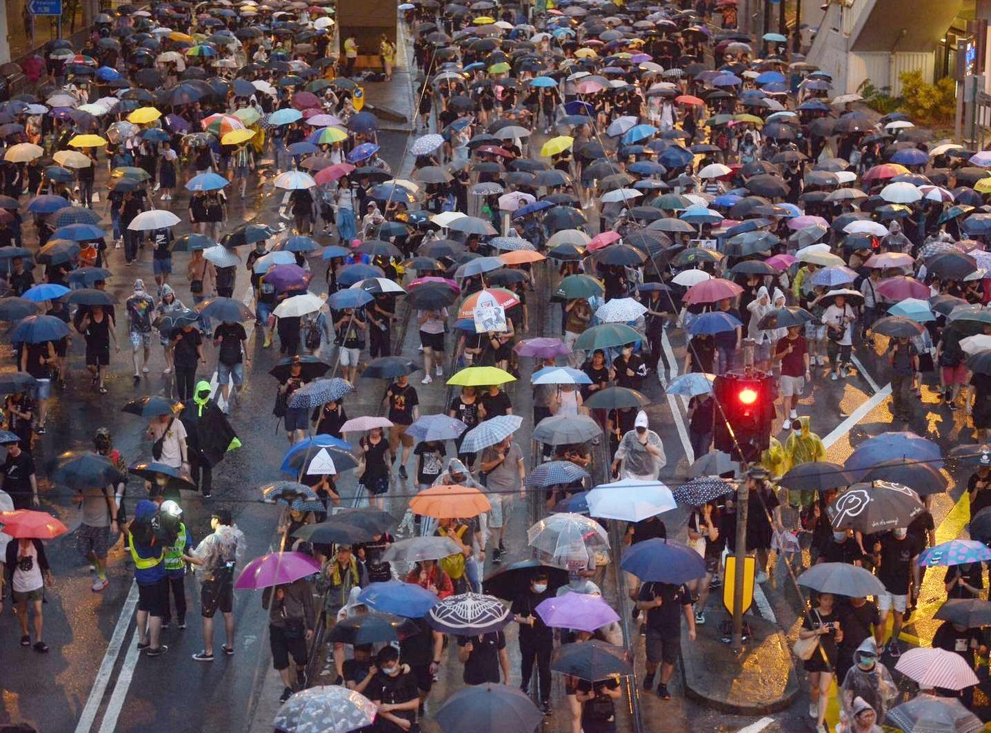 警方估計,在昨日的集會中,同一時間內出席的最高峰人數為12.8萬人。資料圖片