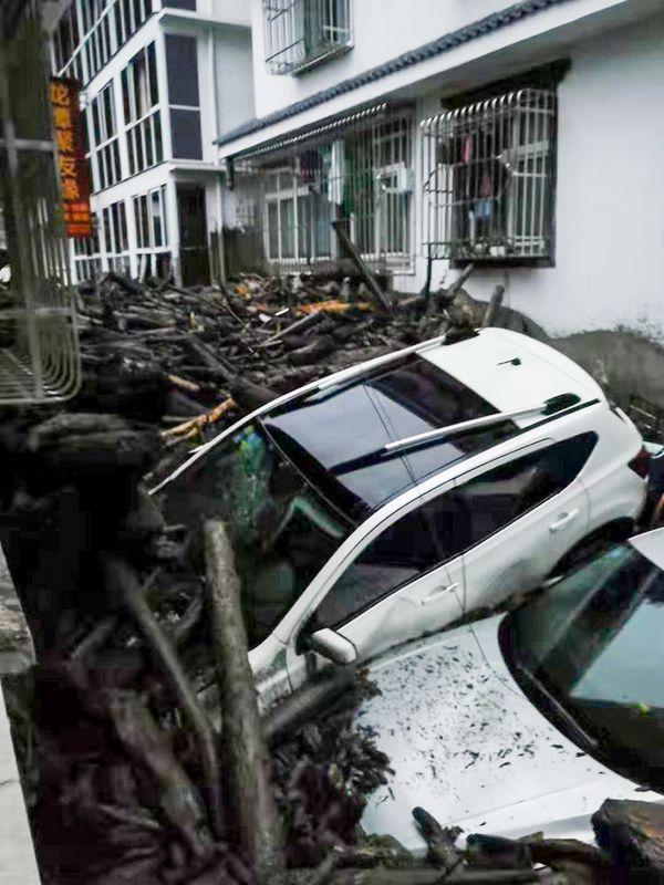 強降雨單在阿壩已導致7人死亡24人失蹤。新華社
