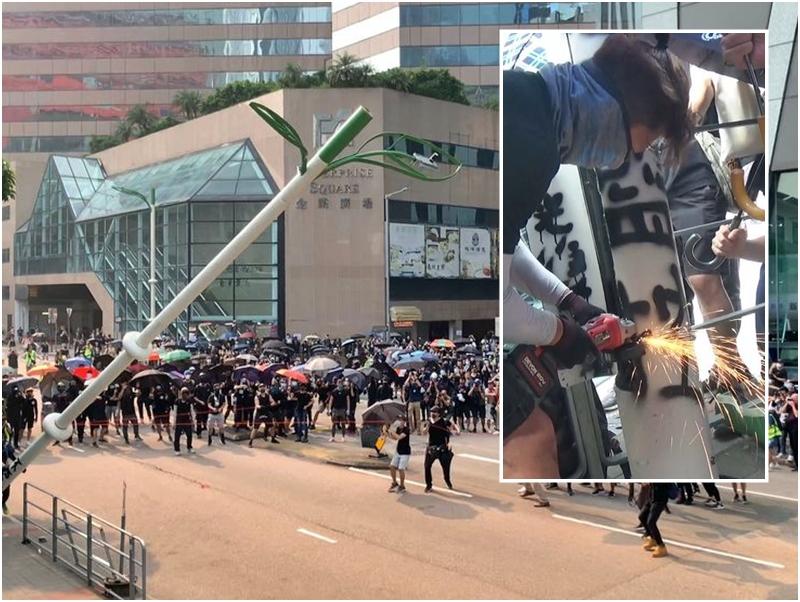 有示威者拆毀智慧燈柱。
