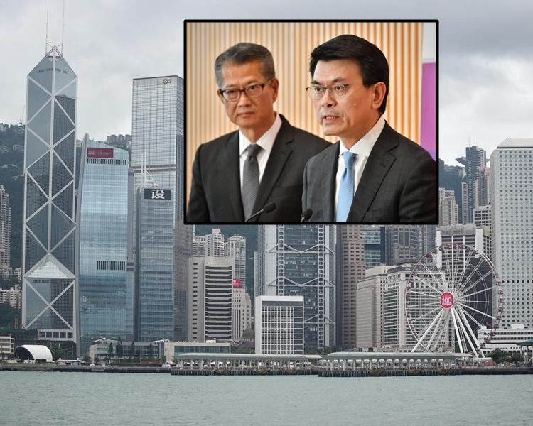陳茂波及邱騰華見記者宣布推出支援中小企業措施。
