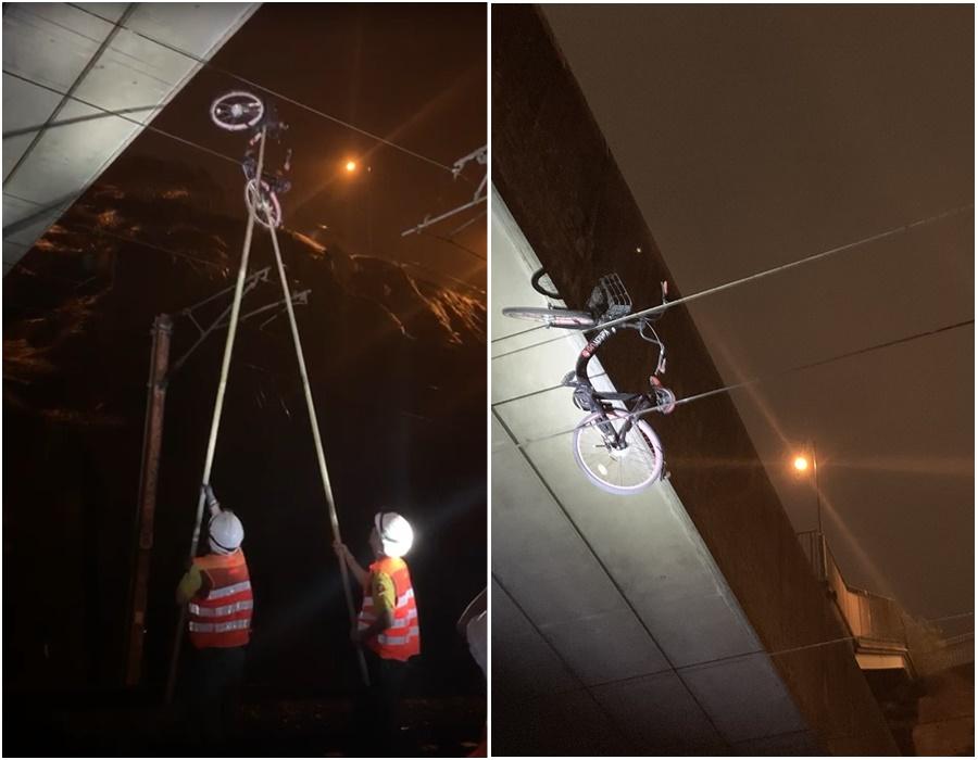 東鐵綫架空電纜上掛有一架單車