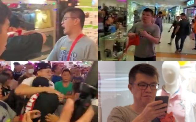 唱國歌男子疑遭黑衣蒙面男子奪去手機,雙方理論,在場人士兩方人士爆發衝突。徐裕民攝