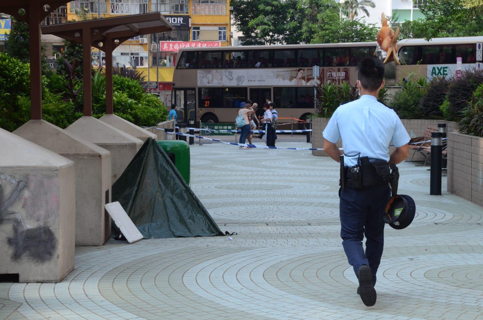 男子倒斃在公園內。 歐陽偉光攝
