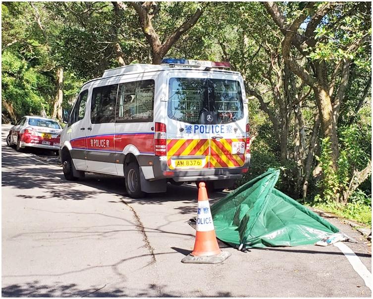 警方以帳篷遮蓋死者遺體。 歐陽偉光攝