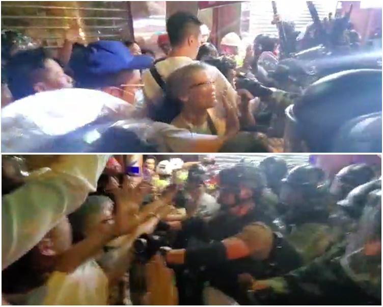 大批沒有裝備「街坊裝」的市民與警察推撞。影片截圖