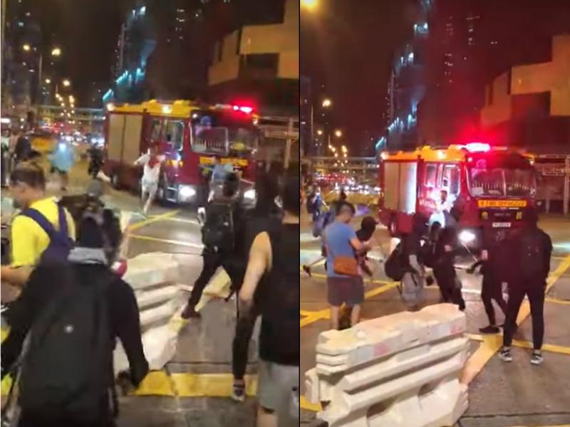 白衣男子在消防車前遇襲。影片截圖