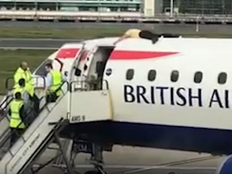 残奥会运动员詹士·布朗趴到英国航空公司的飞机顶上。(网图)