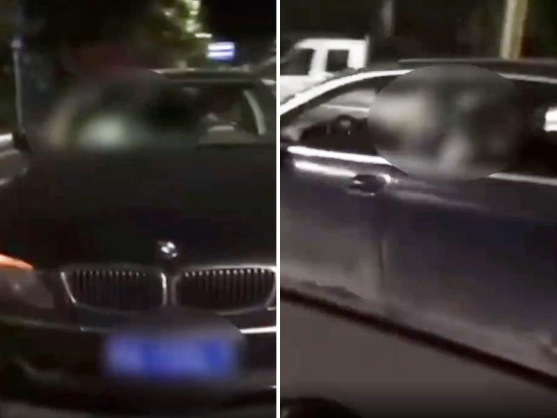 廣西省巴馬縣一輛寶馬私家車日前停在鬧區「車震」。影片截圖