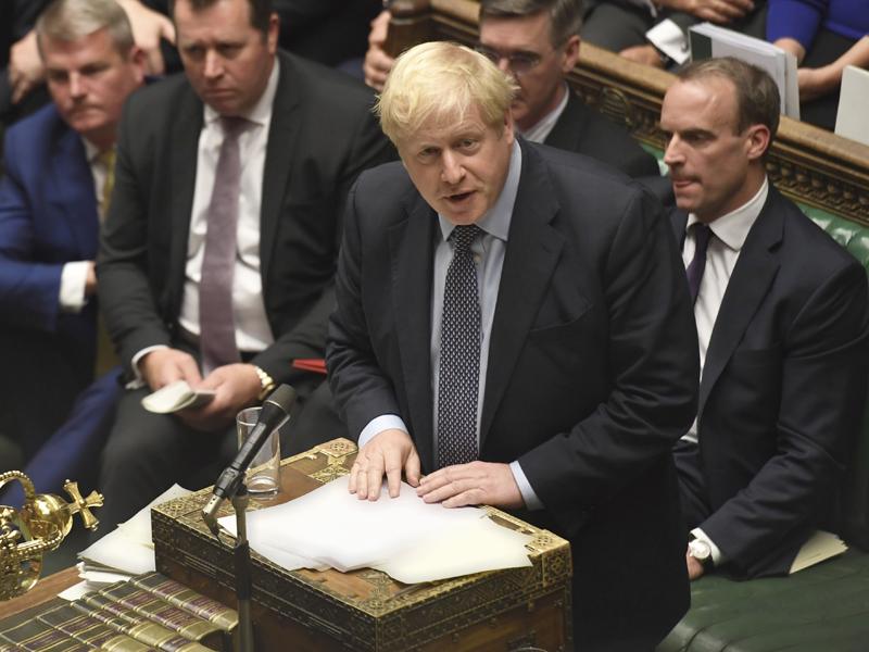 約翰遜誓言21日(周一)將他與歐盟達成的脫歐協議交付下議院表決。AP
