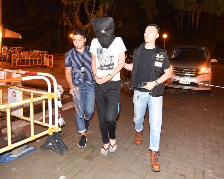 盧溢燊當日被警方拘捕情形。資料圖片