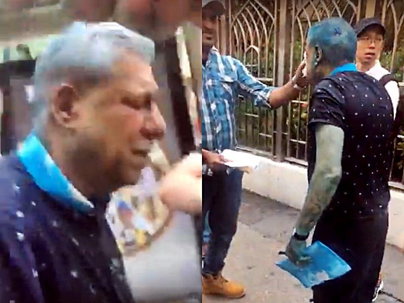印度協會前主席毛漢褚簡寧昨被噴藍水。