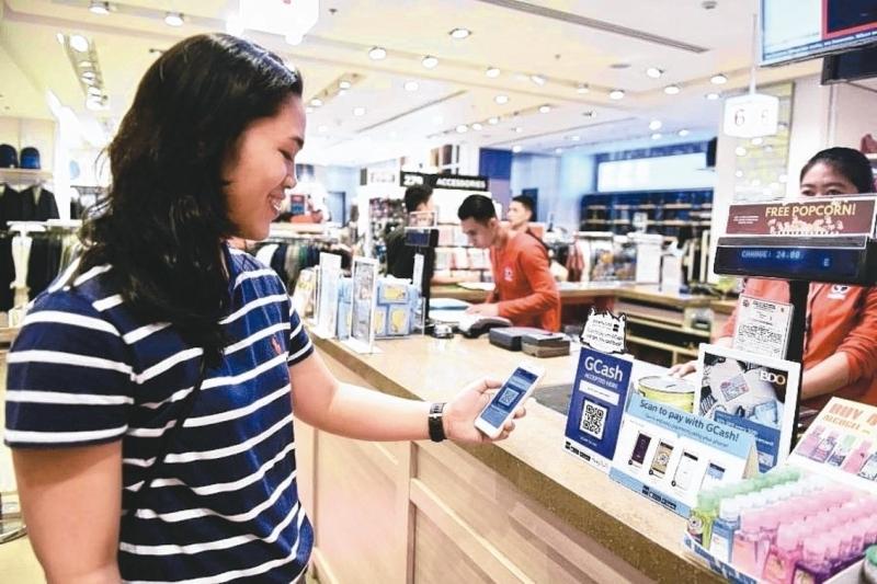 中國人民銀行發布報告稱,內地成年人近九成擁有活躍賬戶,超八成使用電子支付。 (新華社)