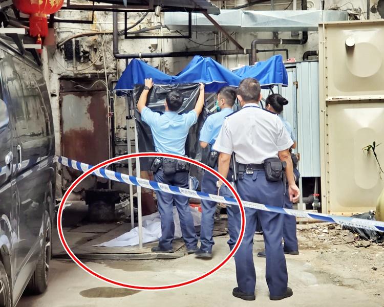 警員以白布及帳篷遮蓋事主遺體(紅圈示)。