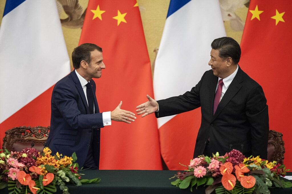 習近平會見到訪的法國總統馬克龍。AP圖片