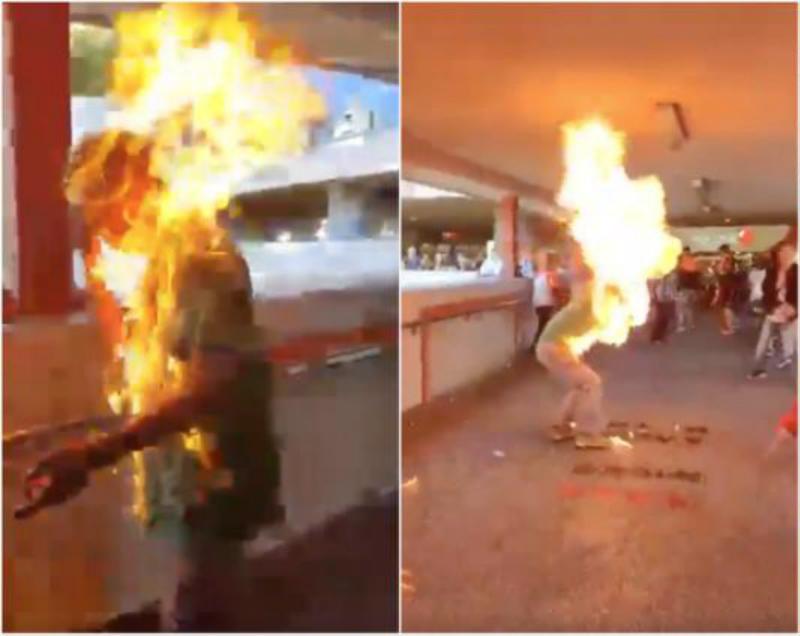 與示威者口角的男子被縱火。網上截圖
