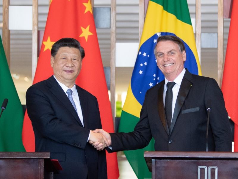 國家主席習近平在巴西利亞同巴西總統博索納羅會談。(新華社)