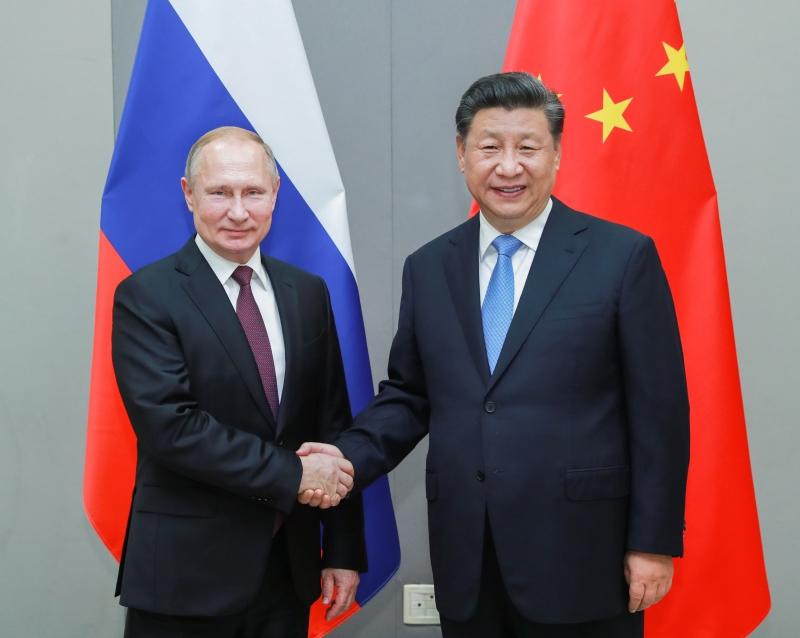 習近平會見俄羅斯總統普京,同意中俄加強戰略合作。(新華社)