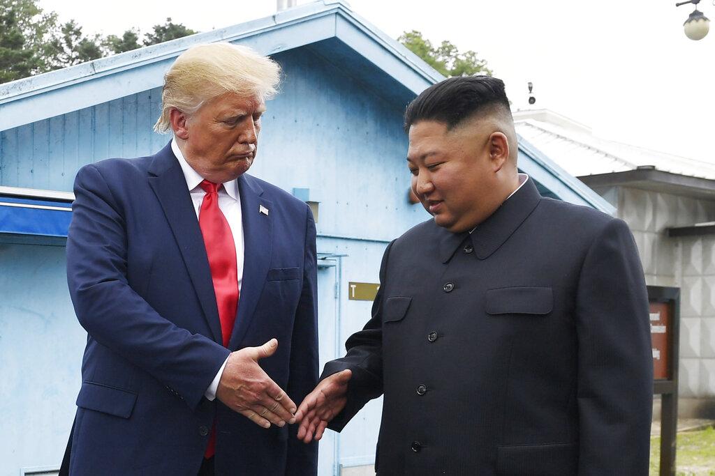 金正恩早前與特朗普見面。AP