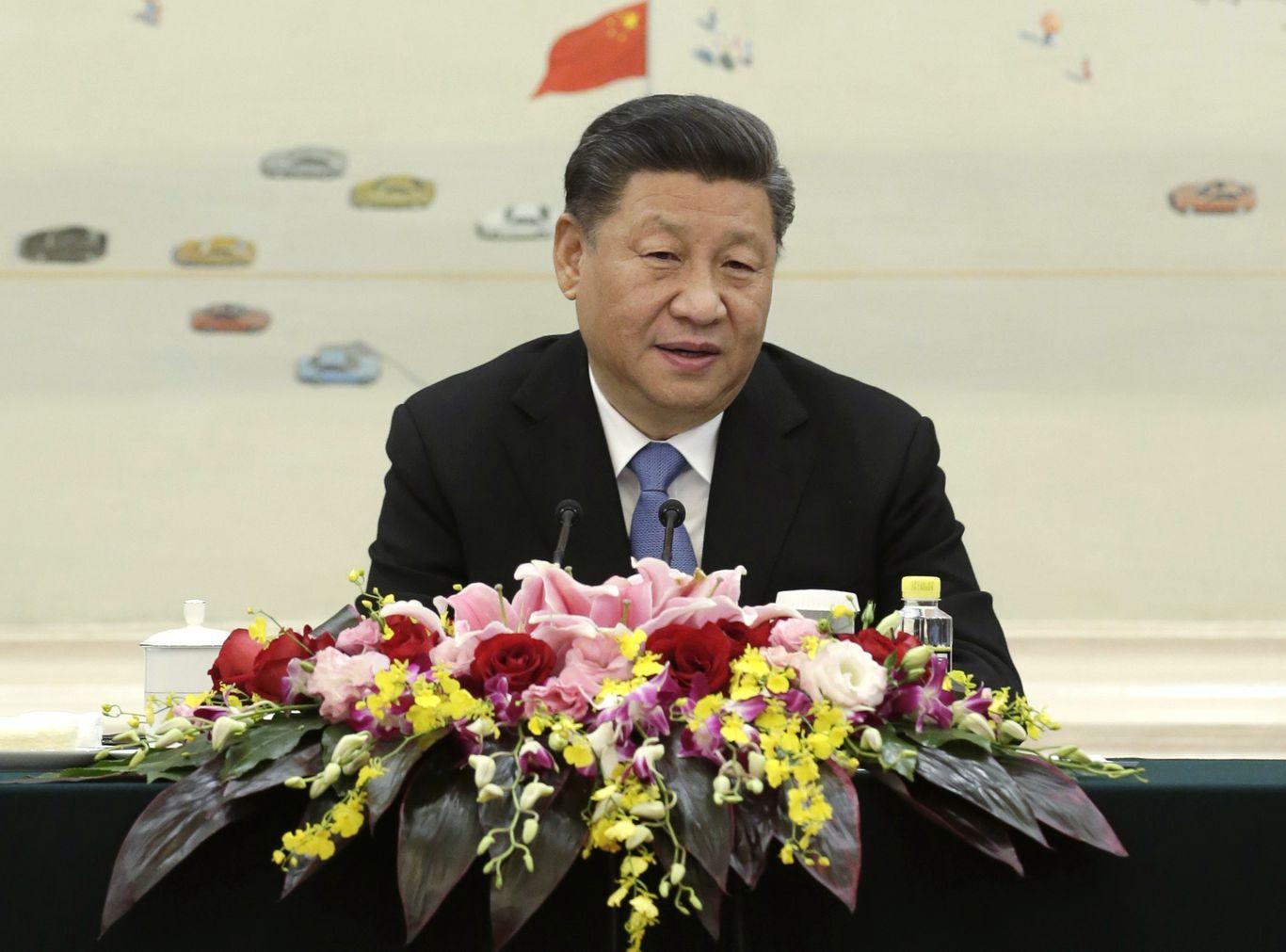 習近平亦強調,中方不怕打貿易戰。AP