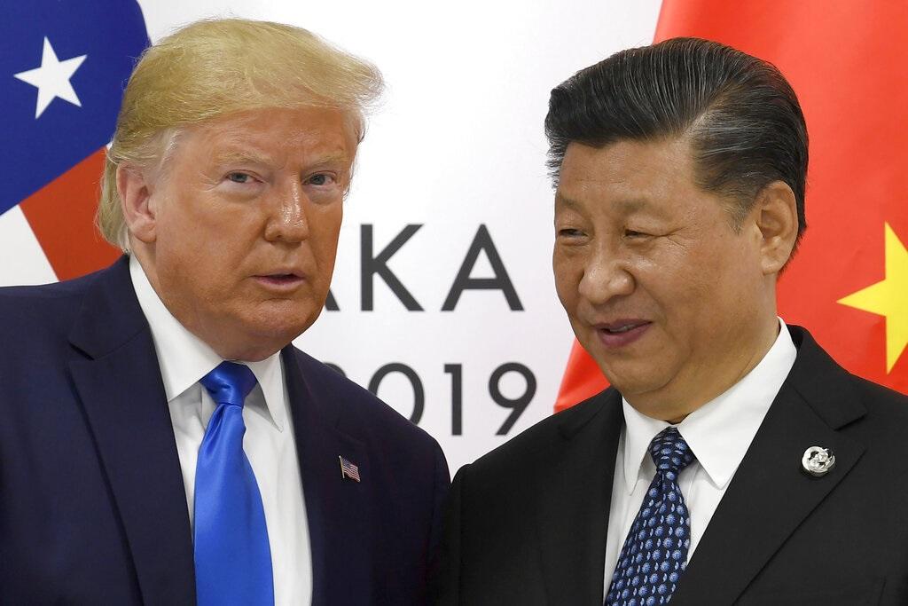 特朗普稱向習近平(右)告誡不要派兵干預香港。AP圖片