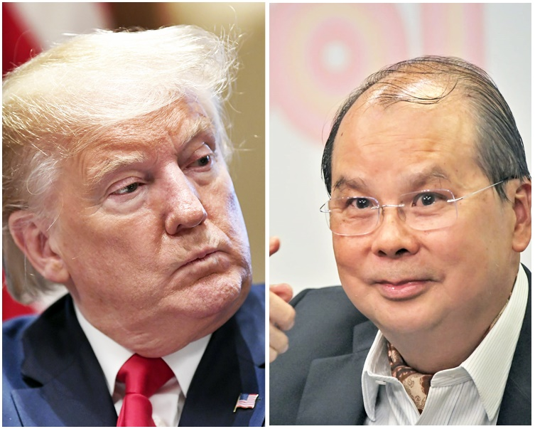 張建宗(右)不評論特朗普(左)的涉港言論。左為AP圖片