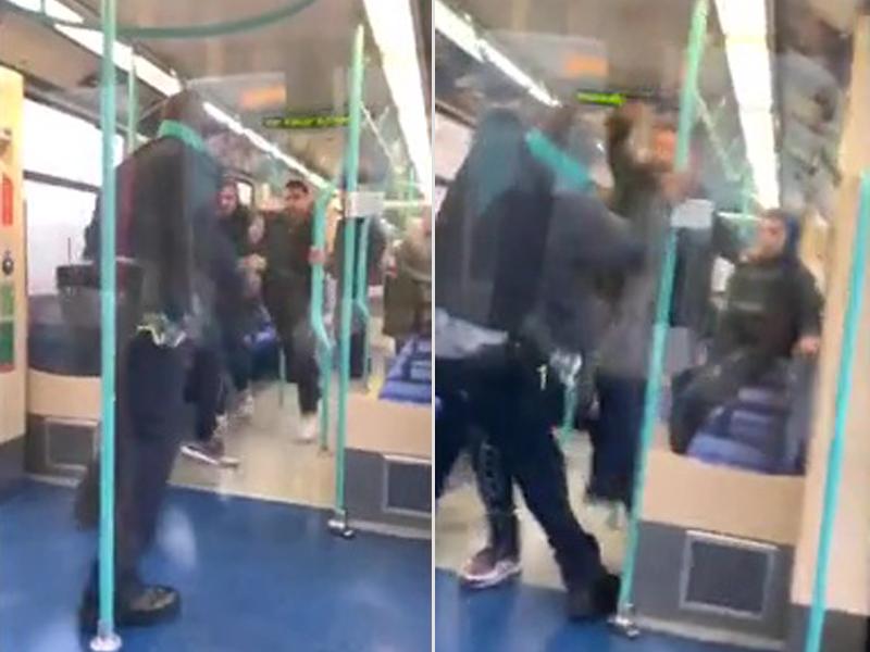 背對鏡頭的檢票員,被「霸位男」及其友人攻擊。(網圖)