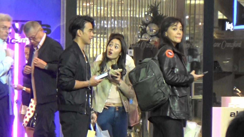 龐景峰(左)與女友何佩珈(中)雞啄唔斷,郭秀雲即識趣擰歪面搵車走。