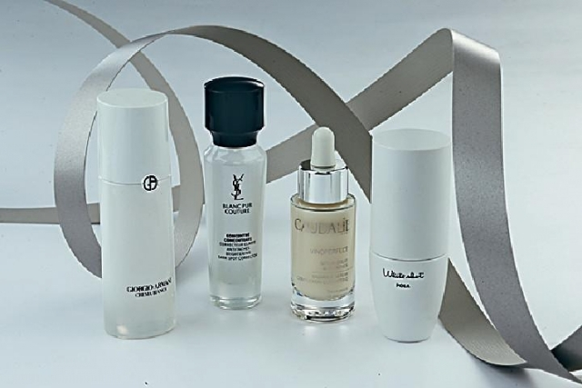左至右 Giorgio Armani Crema Bianca Supreme Brightening Concentrate$2,950 YSL Blanc Pur Couture Concentrate$820 Caudalíe Vinoperfect Radiance Serum$510 Pola White Shot CX$1,360