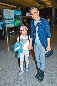 譚順生表示是帶女兒Celine外遊。