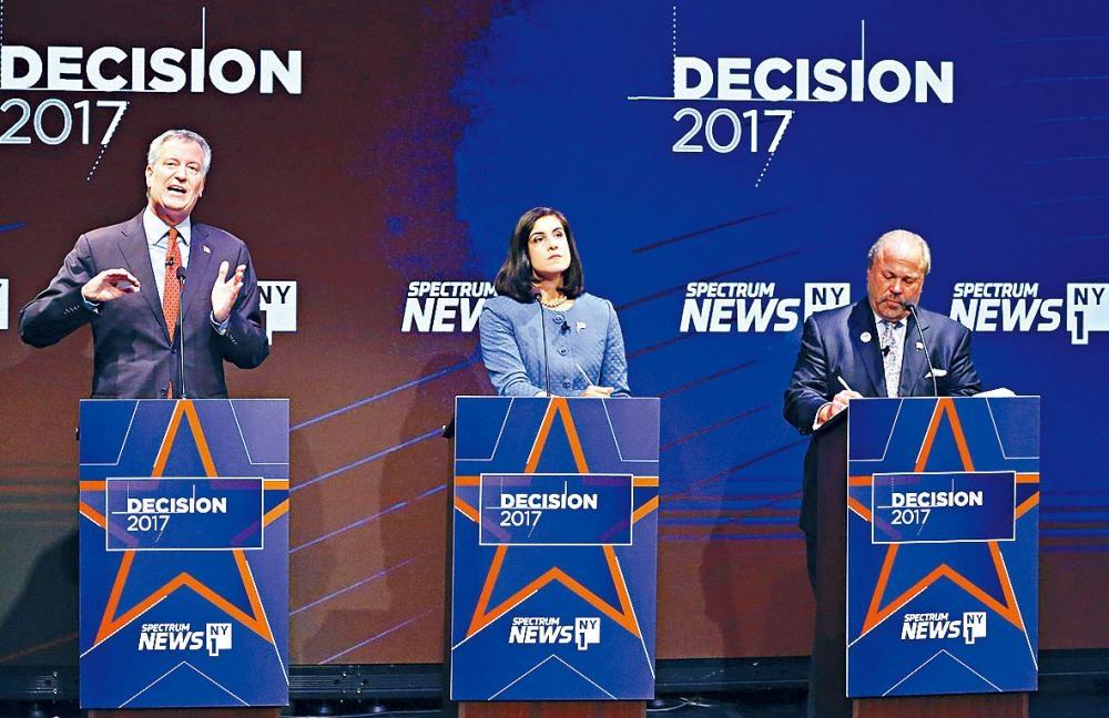 第一場市長辯論氣氛激烈,三名候選人就多個問題針鋒相對。美聯社