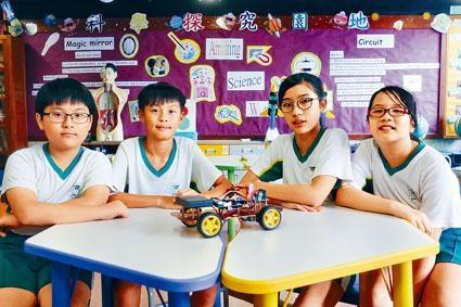 景林天主教小學四位參賽同學(上圖左起)謝琇玕、林翰琛、黃愛霖和黃俊熙。
