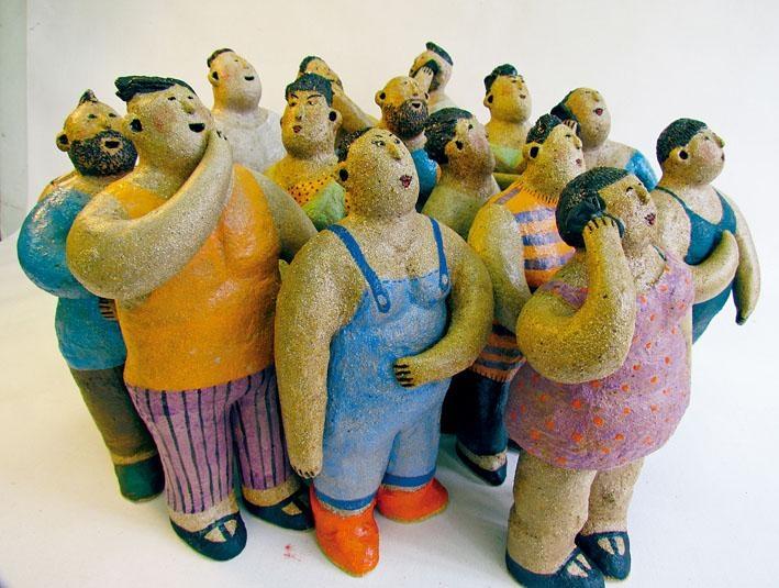 幽默胖子的陶塑讓人倍感親切。