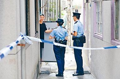 元朗東頭圍新村,父殺死智障子現場。