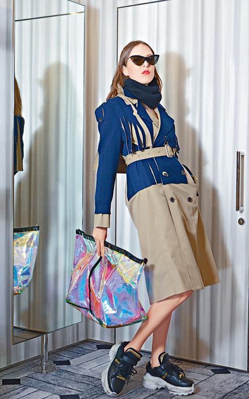 品牌與Mykita聯乘的太陽眼鏡、黑色針織Neckwear、對比色配流穗裝飾Trench Coat、Retro Fit黑色小牛皮波鞋、幻彩透明大型號Clutch。