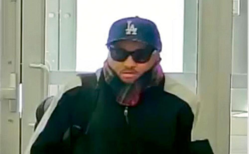 涉嫌行劫銀行被的疑匪。多市警方
