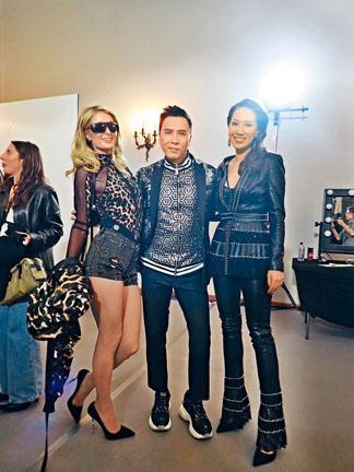 ■子丹與太太汪詩詩(右)同行,於後台與名媛Paris Hilton開心見面。