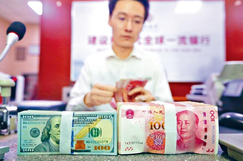 人民幣官方中間價再創五個月新低,周四報6.8994。