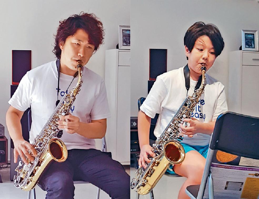 ■12歲大仔日希現學玩色士風,兩父子經常合奏。
