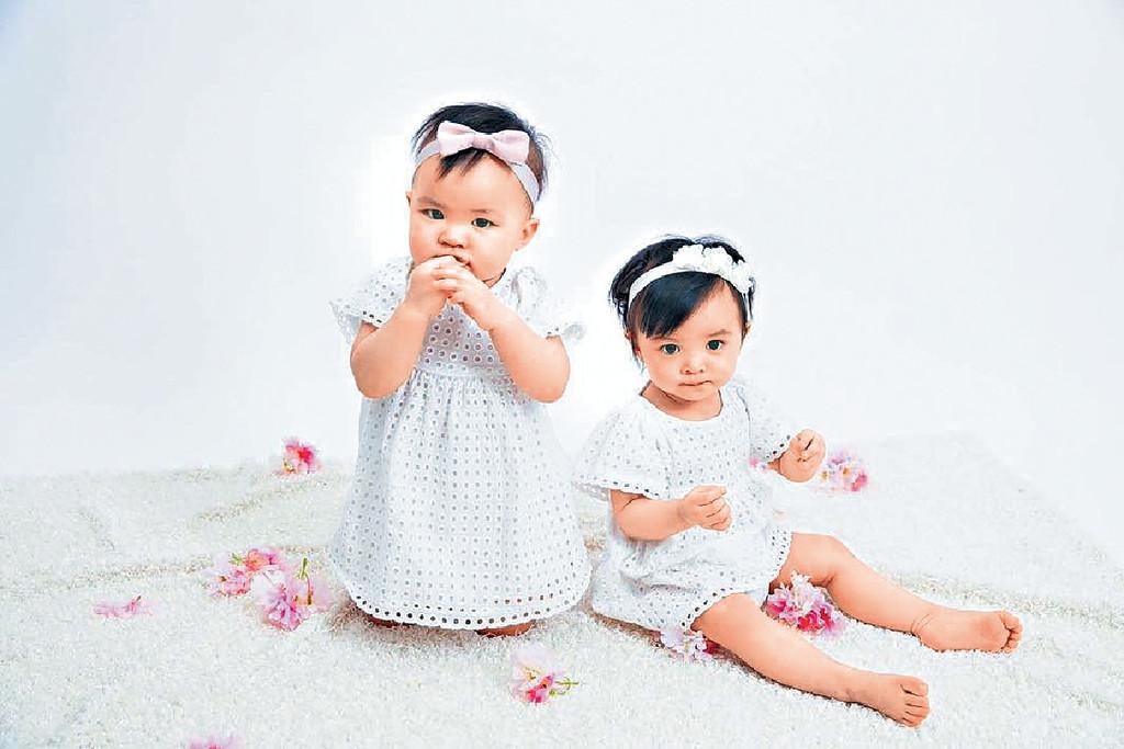 一歲寫真 ■大孖Kaylor(右)似爸爸,妹妹Lyvia則似媽媽。